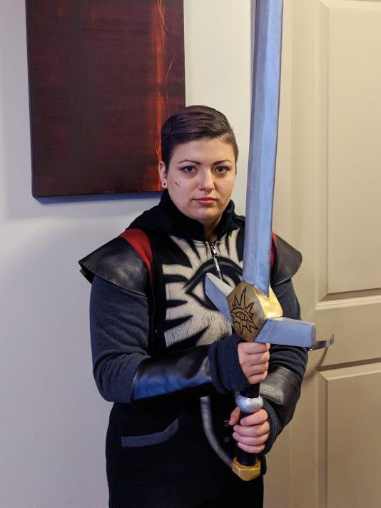 Veronica, as Cassandra, holding the cosplay foam sword