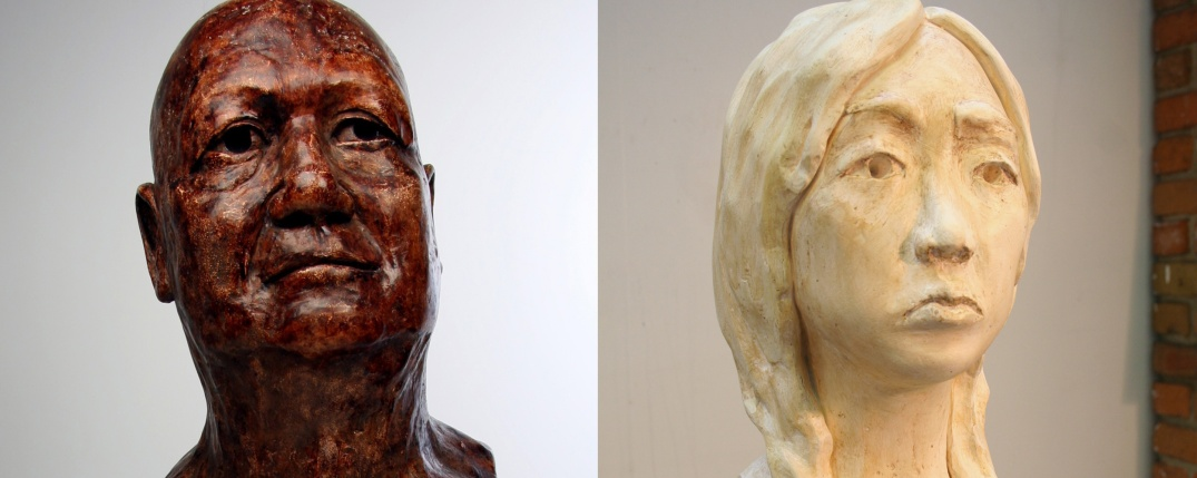 two plaster bust sculptures