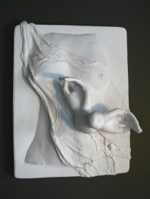 A plaster relief sculpture