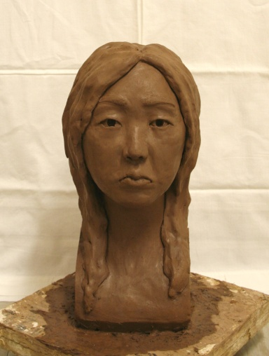 Front view of the initial clay sculpture