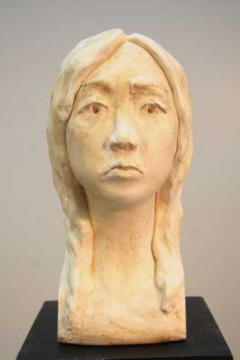 Front view of final plaster bust