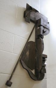 A wooden abstract sculpture