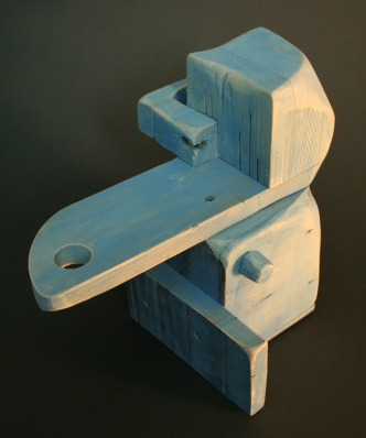 A small wooden abstract sculpture