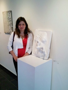 """Veronica standing by her piece """"For a Friend"""""""