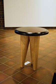 A small side table on display at an exhibition